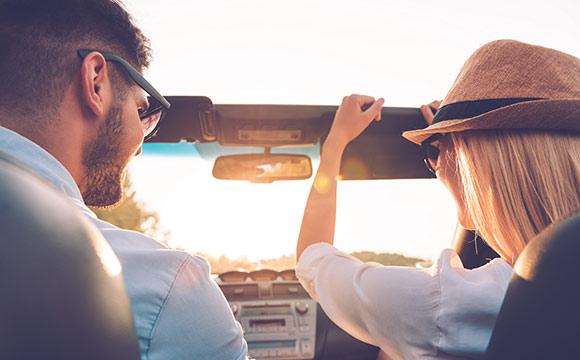 Couple in open top car