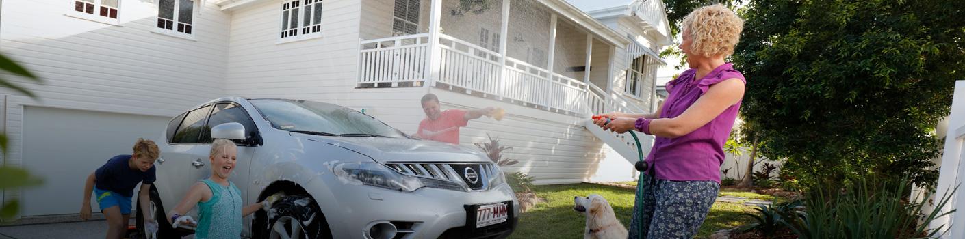 Family washing car and having fun