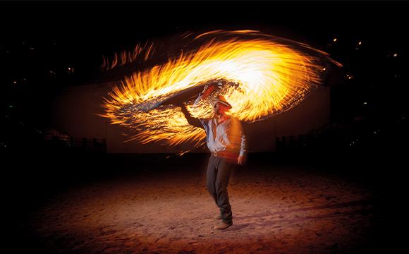 man swinging fire whip