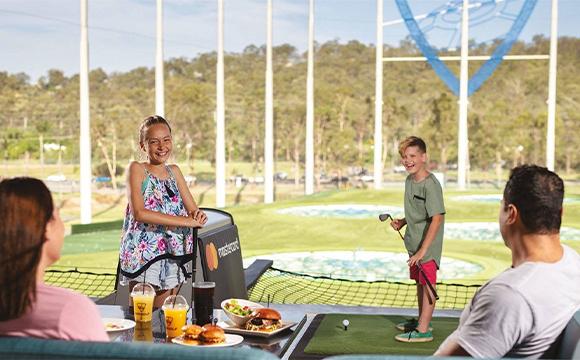Family having fun at top golf