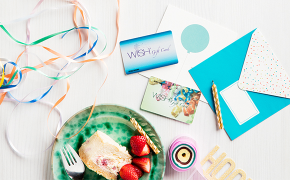 wish gift cards and cake on a table