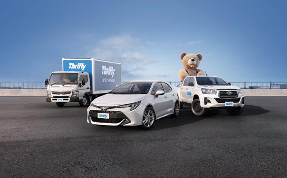 Thrifty car, ute, truck and big teddy bear