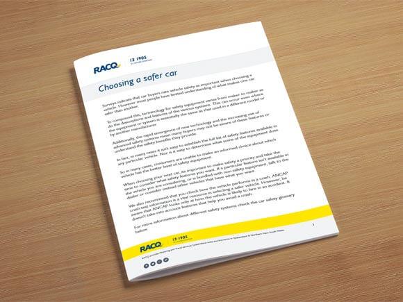 Printed RACQ factsheet sitting on desk