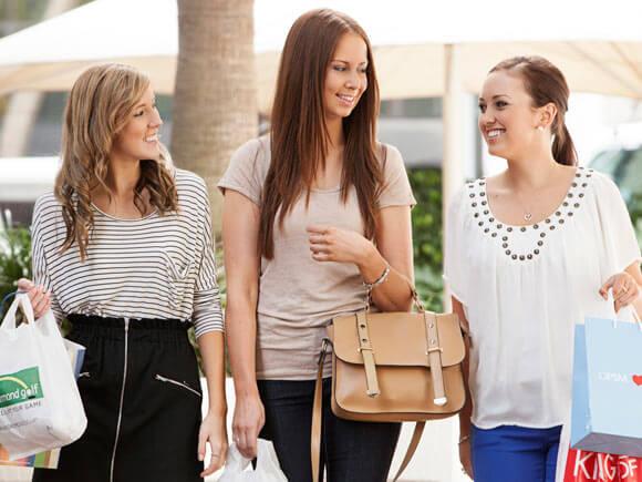 Three young women enjoying a shopping trip together