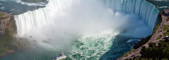 Boat venturing into the spray of Niagra Falls