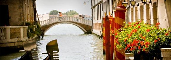 Couple crossing a canal bridge in Venice