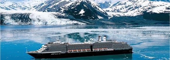 Cruise ship passing mountains in Alaska