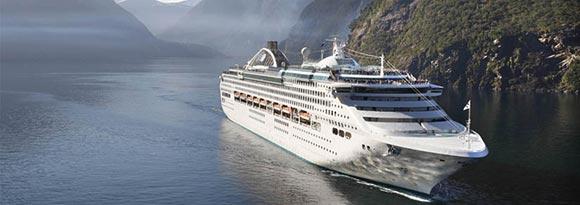 Cruise ship passing through misty mountains