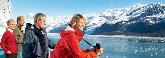 Passengers enjoying a cruise through Alaska