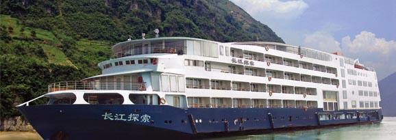 The Yangtze Explorer ship cruising by mountains in China
