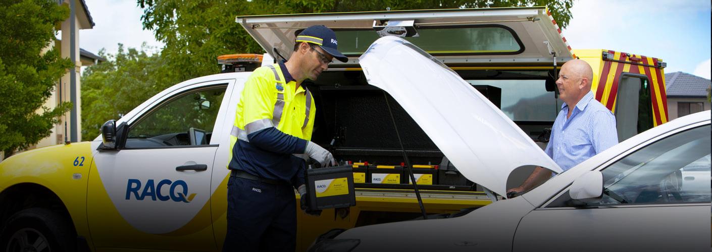 RACQ technician installing a new car battery