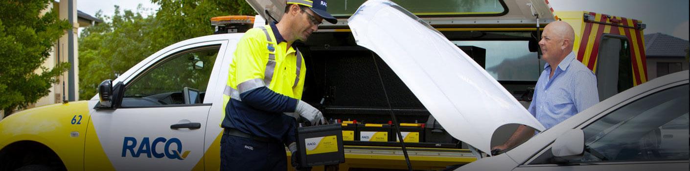 RACQ technician installing a new battery